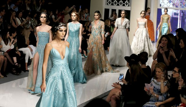 """Models display creations from the """"A Beryth 2016"""" collection by Lebanese designer Shady Zeineldine during the opening of Beirut Fashion Week in Beirut, Lebanon April 19, 2016. (Photo by Mohamed Azakir/Reuters)"""