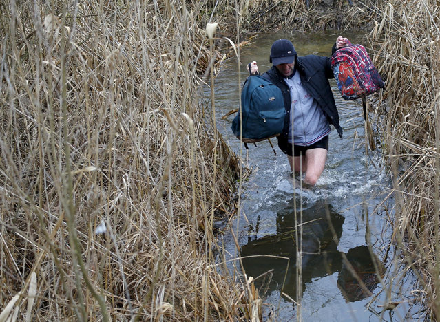 A Kosovar man crosses the water as he illegaly crosses the Hungarian-Serbian border near the village of Asotthalom, Hungary in this February 6, 2015 file photo.  Hungary announced plans on Wednesday to build a four-meter-high fence along its border with Serbia to stem the flow of illegal migrants, in a move likely to annoy human rights groups and the European Union. The landlocked central European country of 10 million people is in the EU's visa-free Schengen zone and thus an attractive destination for tens of thousands of migrants entering Europe through the Balkans from the Middle East and beyond.     REUTERS/Laszlo Balogh /Files