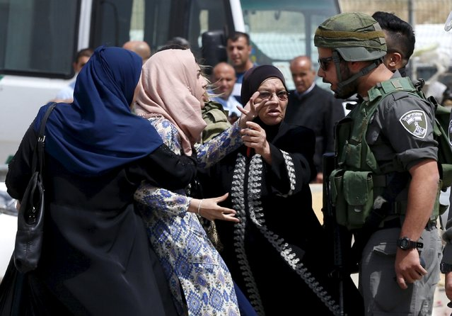 A Palestinian woman argues with an Israeli border policeman near the scene where a Palestinian woman and a man, who the Israeli military said tried to stab security forces, were shot dead by Israeli police near Qalandia checkpoint near the West Bank city of Ramallah April 27, 2016. (Photo by Ammar Awad/Reuters)