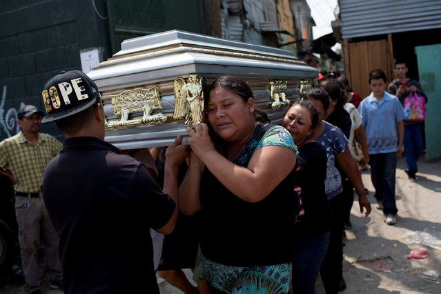Family members and friends carry the coffin of Juana Martina Villata, a garbage collector who was killed after a massive pile of garbage collapsed and buried her at a landfill dumpsite, toward the cemetery in Guatemala City, Guatemala, April 29, 2016. (Photo by Saul Martinez/Reuters)