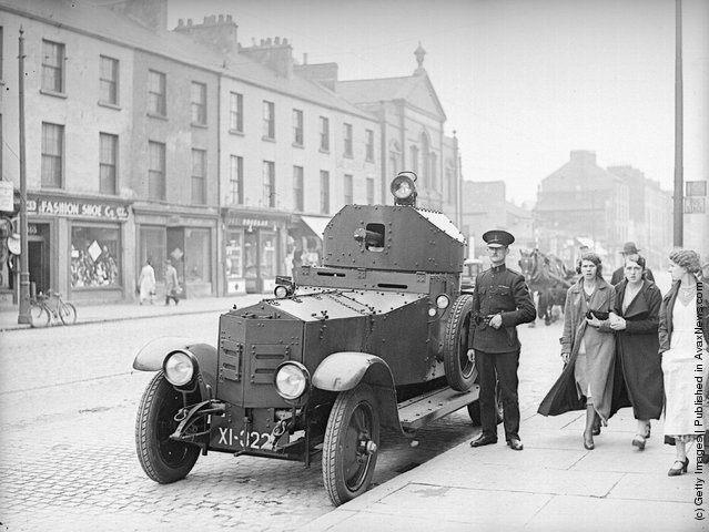 1935:  A British Army Rolls Royce armoured car outside the Royal Ulster Constabulary police station on York Street in Belfast following riots after an Orange Order parade
