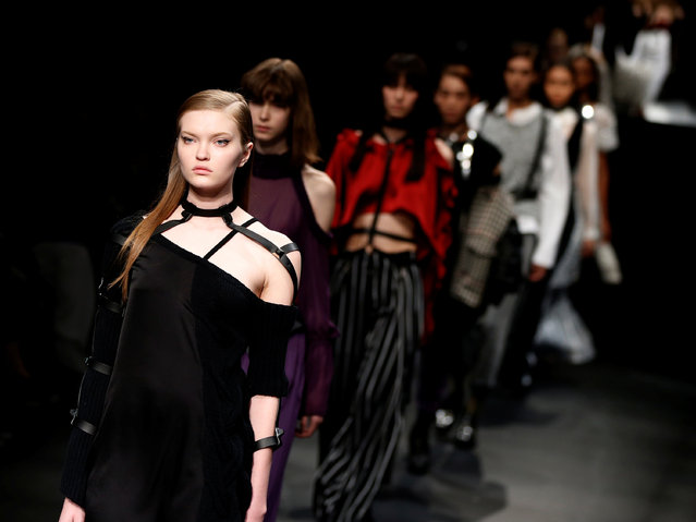 Models present creations by designer Yukimi Kawashima from her Autumn/Winter 2017 collection for her brand AULA during Tokyo Fashion Week in Tokyo, Japan March 20, 2017. (Photo by Toru Hanai/Reuters)