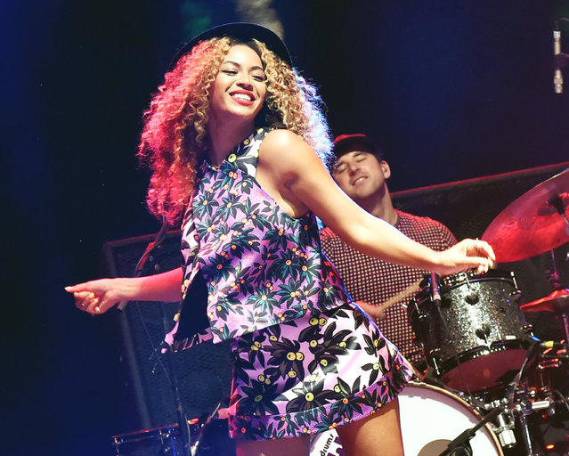 Singer Beyonce performs with her sister Solange onstage during day 2 of the 2014 Coachella Valley Music & Arts Festival at the Empire Polo Club on April 12, 2014 in Indio, California. (Photo by Jeff Kravitz/FilmMagic)