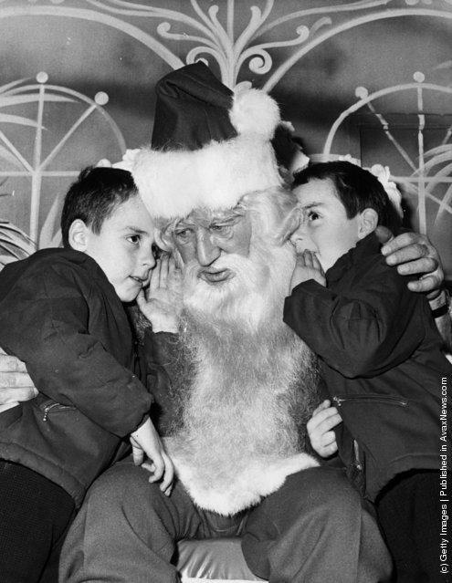 1970: A pair of five year old twins tell Father Christmas what they want for their presents at Selfidges in Oxford Street