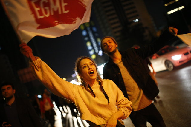 "Supporters of pro-""no"" vote chant slogans as they protest against the referendum outcome, in Istanbul, early Monday, April 17, 2017. Hundreds of demonstrators marched in a central neighbourhood in Istanbul, clanking pots and pans and chanting ""this is just the beginning, the struggle will continue"". (Photo by Emrah Gurel/AP Photo)"