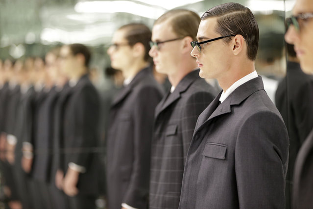 Models stand in a mirrored room during a presentation by Thom Browne at Men's Fashion Week in New York, Tuesday, July 14, 2015. The inaugural New York Men's Fashion Week runs through Thursday. (Photo by Seth Wenig/AP Photo)