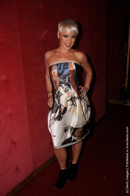 Pink poses backstage at a party to celebrate the release of Pink's new album 'Funhouse' at Cafe De Paris, Leicester Square