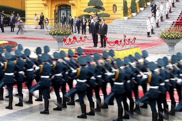 US President Barack Obama (C-L) and Vietnam's President Tran Dai Quang (C-R) review an honor guard at the Presidential Palace in Hanoi, Vietnam, 23 May 2016. US President Barack Obama visits Vietnam for the first time from 23 to 25 May 2016, making him the third US President to visit the South East Asian country since the end of the Vietnam War in 1975. During the first day of his visit Obama announced that the US will lift its arms embargo on weapon sales to Vietnam. (Photo by Minh Hoang/EPA)