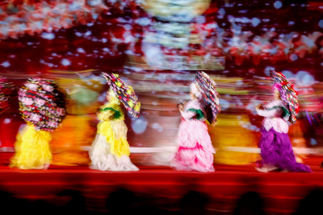 A photo made with a slow shutter speed effect show performers dancing during the opening ceremony of the 35th Association of Southeast Asian Nations (ASEAN) Summit at IMPACT Muang Thong Thani in Nonthaburi province, Thailand, 03 November 2019. Thailand is hosting the 35th ASEAN Summit, which runs from 02 to 04 November 2019. (Photo by Diego Azubel/EPA/EFE)
