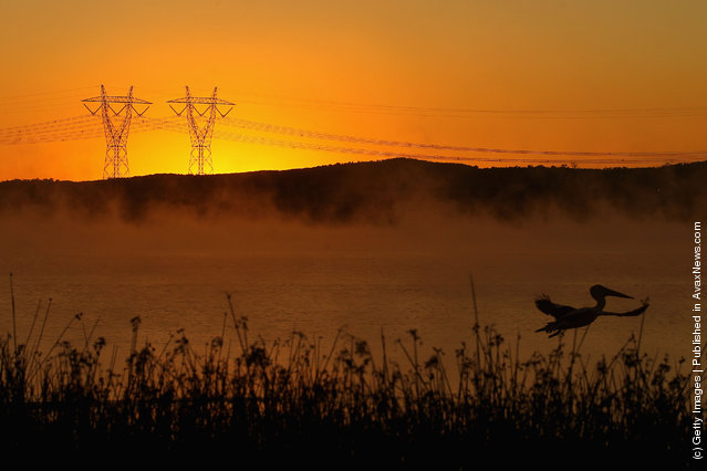 A view of the Hazelwood Power Station across the cooling pondage at sunrise in Melbourne, Australia
