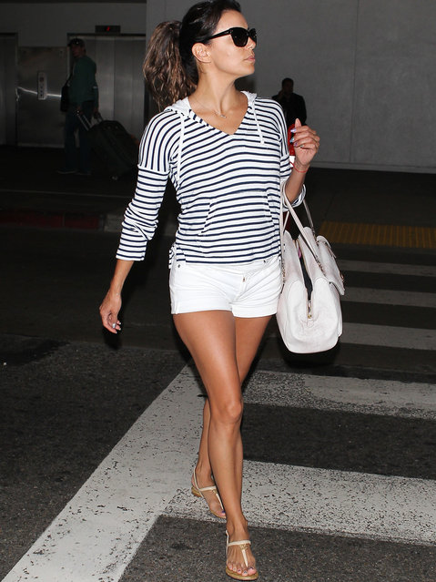 Eva Longoria is seen at LAX, on April 17th, 2014. (Photo by BauerGriffin LLC)