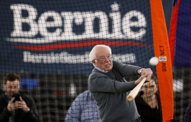 Democratic presidential candidate Sen. Bernie Sanders, I-Vt., hits a baseball after a meeting with minor league baseball players and officials at FunCity Turf, Sunday, December 15, 2019, in Burlington, Iowa. (Photo by Charlie Neibergall/AP Photo)
