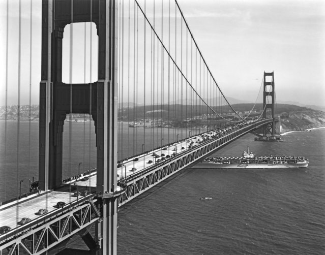 A US Navy aircraft carrier going under the Golden Gate Bridge during opening day ceremonies for traffic on the bridge, San Francisco, California, May 28, 1937. (Photo by Underwood Archives/Getty Images)
