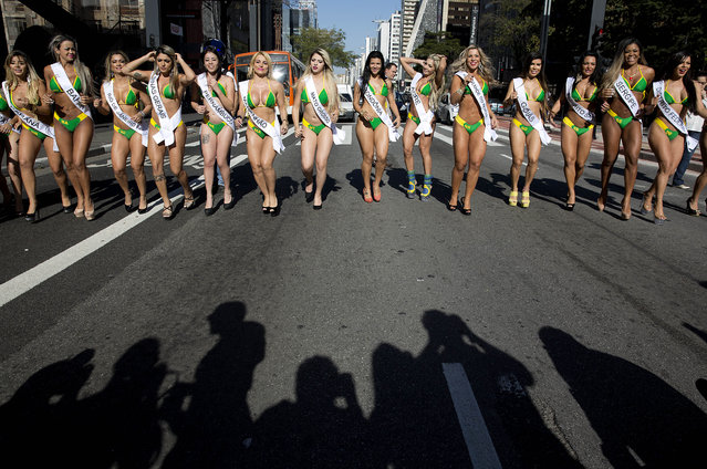 Miss BumBum Brazil contestants walk in the middle of Paulista Avenue to promote their beauty contest in the financial district of Sao Paulo, Brazil, Monday, August 3, 2015. The contest is set for November. (Photo by Andre Penner/AP Photo)