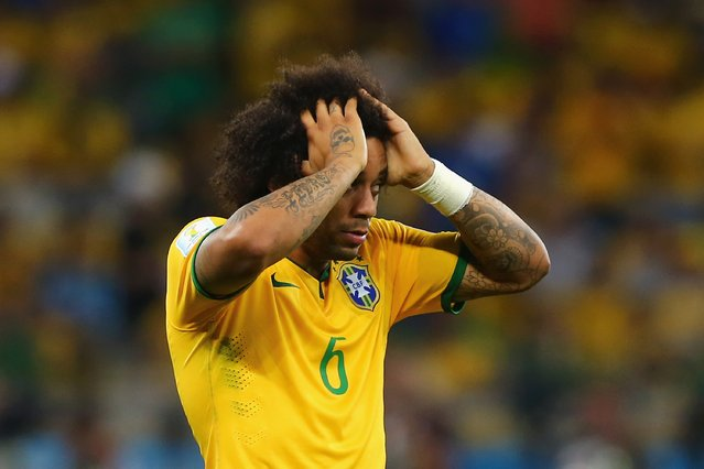 Marcelo of Brazil reacts after allowing a goal during the 2014 FIFA World Cup Brazil Semi Final match between Brazil and Germany at Estadio Mineirao on July 8, 2014 in Belo Horizonte, Brazil. (Photo by Martin Rose/Getty Images)