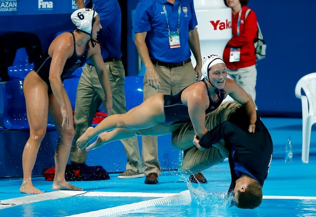 U.S. players push head coach Adam Krikorian into the pool after they defeated the Netherlands in their women's water polo gold medal match during the Aquatics World Championships in Kazan, Russia, August 7, 2015. (Photo by Michael Dalder/Reuters)