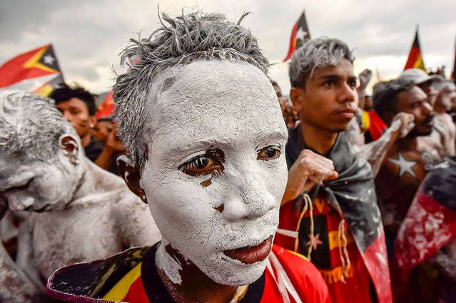Fretilin party supporters participate in an election campaign rally in Dili, East Timor on July 19, 2017. East Timor's parliamentary election will take place on July 22. (Photo by Valentino Dariel Sousa/AFP Photo)