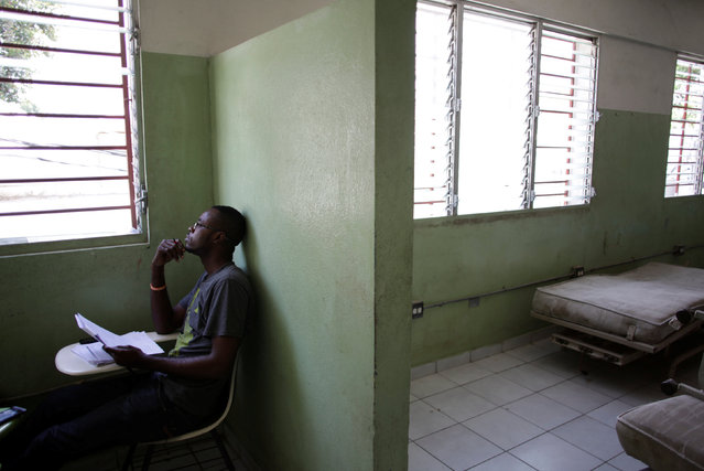 A student studies in an empty room at the Hospital of the State University of Haiti, which is one of the centers affected by a three-month-long strike by health workers demanding a pay rise and resources, in Port-au-Prince, Haiti, June 20, 2016. (Photo by Andres Martinez Casares/Reuters)