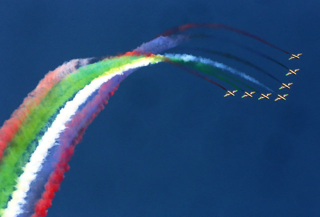 Al-Fursan, the United Arab Emirates Air Force display team, paints the sky with MB339 aircrafts during the Kuwait aviation show in Kuwait City on January 16, 2020. (Photo by Yasser Al-Zayyat/AFP Photo)