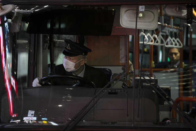A bus driver wearing a mask leaves a bus stop Thursday, January 30, 2020, in Tokyo. The country began evacuating Japanese citizens on Wednesday from the Chinese city Wuhan hardest-hit by the virus. (Photo by Jae C. Hong/AP Photo)
