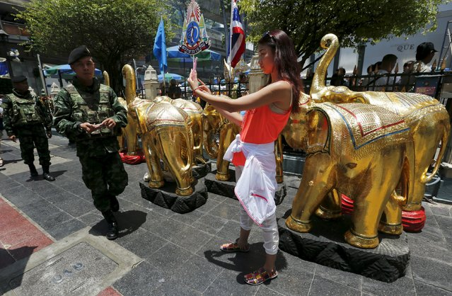 Military personnel patrol around the Erawan shrine, the site of Monday's deadly blast, in central Bangkok, Thailand, August 20, 2015. International terrorists were not suspected of the bomb attack in Bangkok this week that killed 20 people and China was not the target, Thai authorities said on Thursday, as police said they believed at least 10 plotters were involved. (Photo by Chaiwat Subprasom/Reuters)