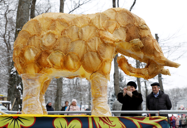 A figure of an elephant covered with pancakes is seen on display during celebrations of Maslenitsa, also known as Pancake Week, which is a pagan holiday marking the end of winter, in Stavropol, Russia on March 1, 2020. (Photo by Eduard Korniyenko/Reuters)