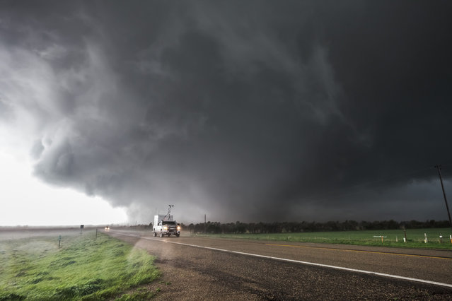 Long-lived supercell produces an EF4 tornado that tracks across northeast South Dakota, just missing the town of Bowdle, May 22, 2010.  Early formation of the wedge is happening west of Bowdle now. (Photo by Mike Hollingshead)