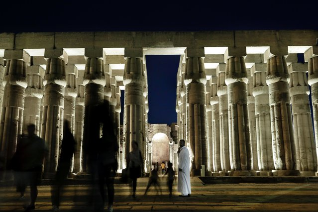 People visit the Luxor Temple in Egypt, Saturday, September 9, 2017. Egypt has announced the discovery in the southern city of Luxor of a pharaonic tomb belonging to a royal goldsmith who lived more than 3,500 years ago during the reign of the 18th dynasty. Antiquities Minister Khaled el-Anani hopes the discovery will boost the country's slowly recovering tourism industry. (Photo by Nariman El-Mofty/AP Photo)