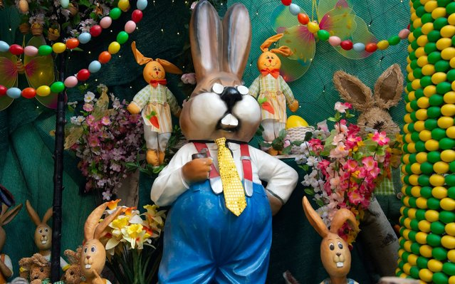 Easter bunnies and Easter eggs are placed in Ernst Langert's Easter barn in the South Thuringian village Hellingen, Germany, Tuesday, April 7, 2020. Despite the coronavirus crises, the Langert family decorated their Easter barn with more than 30,000 Easter eggs and 500 Easter bunnies like every year. Unfortunately they cannot open their tourist attraction to the public during the Easter time. (Photo by Jens Meyer/AP Photo)