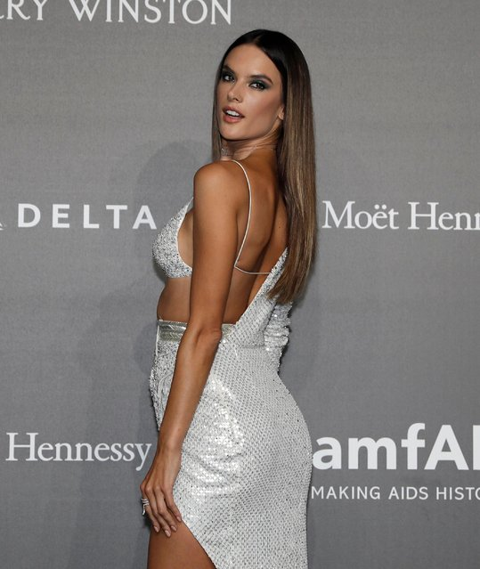 Model Alessandra Ambrosio poses as she arrives for the amfAR charity dinner during the fashion week in Milan, Italy, Thursday, September 21, 2017. (Photo by Antonio Calanni/AP Photo)