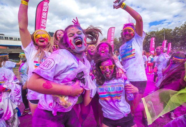 People take part in The Color Run in Brussels, Belgium September 6, 2015. The Color Run is a five-kilometre, untimed race, held in cities worldwide, with the aim of promoting healthy living. Participants are doused from head to toe in different colors at each kilometre. (Photo by Yves Herman/Reuters)