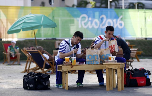 Athletes from Taiwan eat inside the Olympic Village in Rio de Janeiro, Brazil August 1, 2016. (Photo by Kai Pfaffenbach/Reuters)