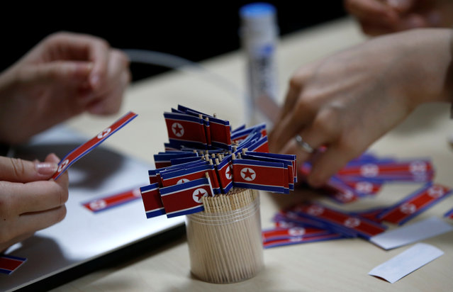 Members of Japan's North Korea fan club called sengun-joshi, or military-first girls, make toothpick North Korean flags in Tokyo, Japan on November 2, 2017. (Photo by Toru Hanai/Reuters)