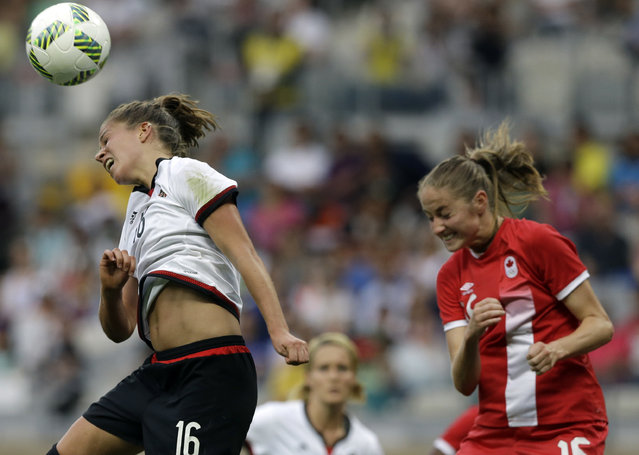 Germany's Melanie Leupolz and Canada's Janine Beckie, right, go for a header during a semifinal match of the women's Olympic football tournament between Germany and Canada at the Mineirao Stadium in Belo Horizonte, Brazil, Tuesday, August 16, 2016. (Photo by Leo Correa/AP Photo)
