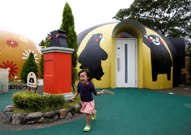 A girl from Singapore runs past a quake-resistant dome house. Despite the light materials, the domes withstood last year's deadly earthquakes in Kumamoto prefecture, where Aso is located, said Masaya Konishi, manager of the Aso Farm Land resort. (Photo by Kim Kyung-Hoon/Reuters)