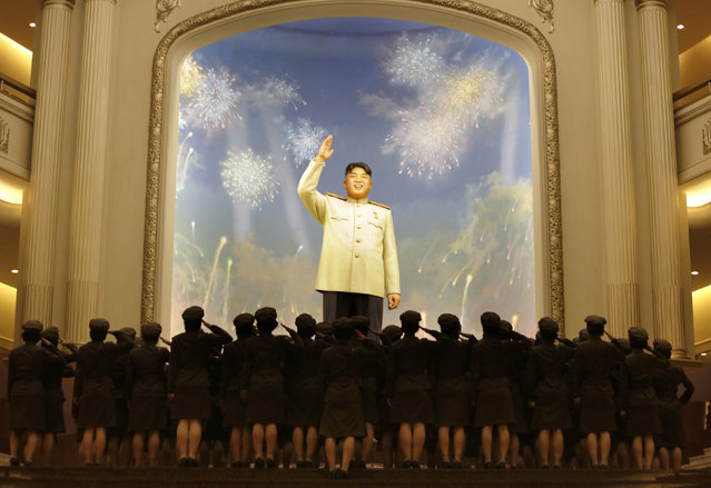 North Korean female soldiers salute a figure of North Korea founder Kim Il-sung during the opening ceremony of the Victorious Fatherland Liberation War Museum, in Pyongyang, July 27, 2013. (Photo by Jason Lee/Reuters)