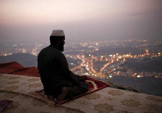 A Muslim pilgrim prays atop Mount Thor in the holy city of Mecca ahead of the annual haj pilgrimage September 19, 2015. (Photo by Ahmad Masood/Reuters)