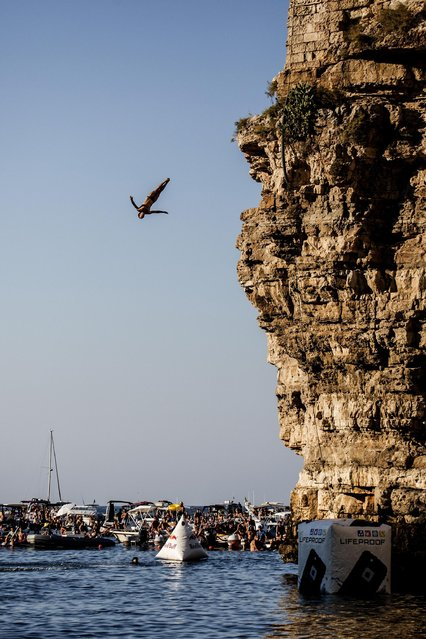 Alessandro De Rose of Italy dives from the 27 metre platform during the fifth stop of the Red Bull Cliff Diving World Series in Polignano a Mare, Italy on August 28, 2016. (Photo by Dean Treml/ANSA/Red Bull Press Office)