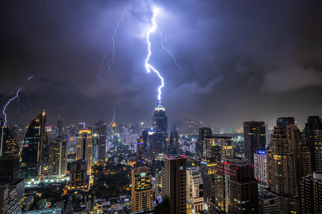 In this picture taken on October 27, 2019 lightening strikes on a building during a thunderstorm in Bangkok, Thailand. (Photo by Mladen Antonov/AFP Photo)