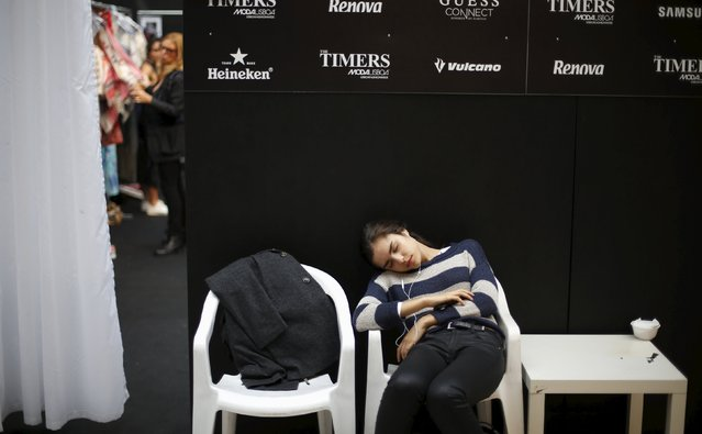 A model rests while waiting backstage before the Christophe Sauvat collection show during Lisbon Fashion Week, Portugal October 10, 2015. (Photo by Rafael Marchante/Reuters)