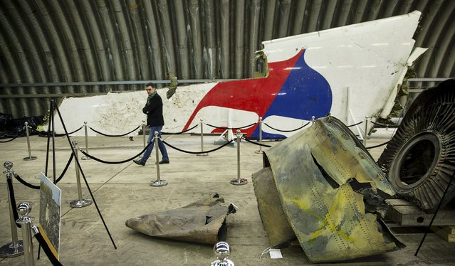Wreckage of the MH17 airplane is seen after the presentation of the final report into the crash of July 2014 of Malaysia Airlines flight MH17 over Ukraine, in Gilze Rijen, the Netherlands, October 13, 2015. (Photo by Michael Kooren/Reuters)