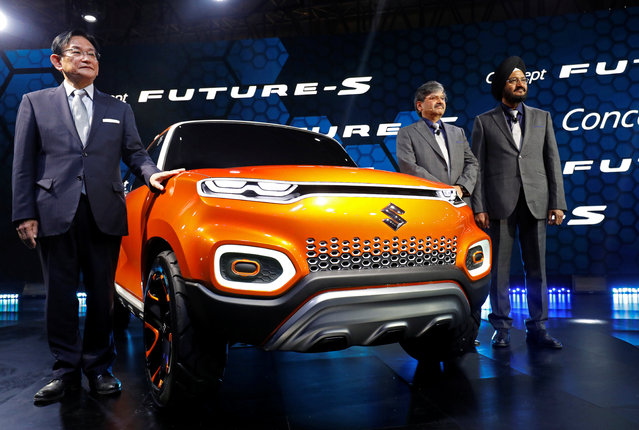 Kenichi Ayukawa, Chief Executive Officer of Maruti Suzuki, CV Raman, Head Research and Development, Maruti Suzuki India Limited, and Randhir Singh Kalsi, Senior Executive Director, Maruti Suzuki India Limited, pose during the launch of Future S concept car at India Auto Expo 2018 in Greater Noida, February 7, 2018. (Photo by Saumya Khandelwal/Reuters)