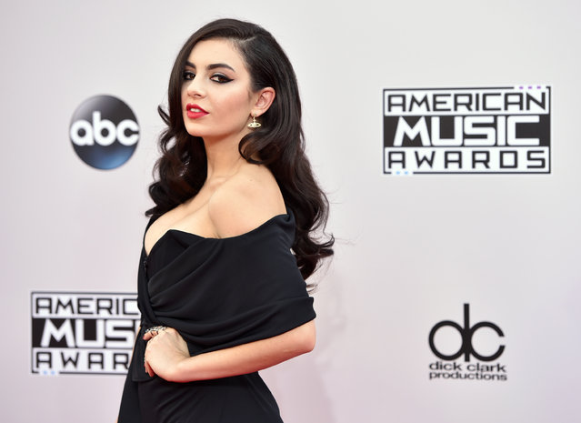 Charli XCX arrives at the 42nd annual American Music Awards at Nokia Theatre L.A. Live on Sunday, November 23, 2014, in Los Angeles. (Photo by John Shearer/Invision/AP Photo)