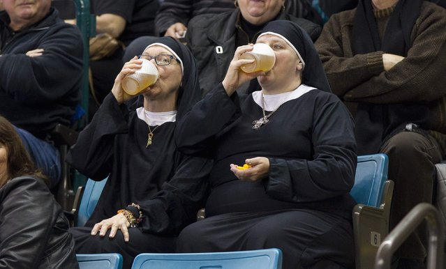 Two women wearing nun outfits drink beer while watching the 2014 Tim Hortons Brier curling championships in Kamloops, British Columbia in this March 8, 2014 file photo. (Photo and caption by Ben Nelms/Reuters)