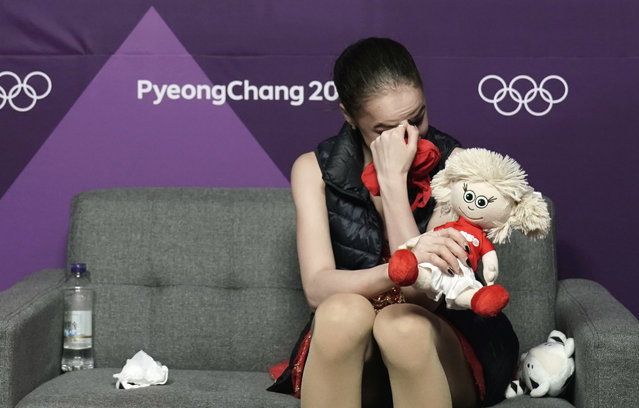 Alina Zagitova of the Olympic Athletes of Russia reacts as realises she has won the gold medal as she watches a television monitor in the green room as compatriot Evgenia Medvedeva wins the silver medal during the women's free figure skating final in the Gangneung Ice Arena at the 2018 Winter Olympics in Gangneung, South Korea, Friday, February 23, 2018. (Photo by David J. Phillip/AP Photo)