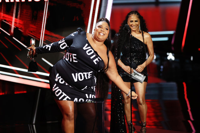 In this image released on October 14, Lizzo accepts the Top Song Sales Artist award onstage for the 2020 Billboard Music Awards, broadcast on October 14, 2020 at the Dolby Theatre in Los Angeles, California. (Photo by: Christopher Polk/NBC/NBCU Photo Bank via Getty Images)