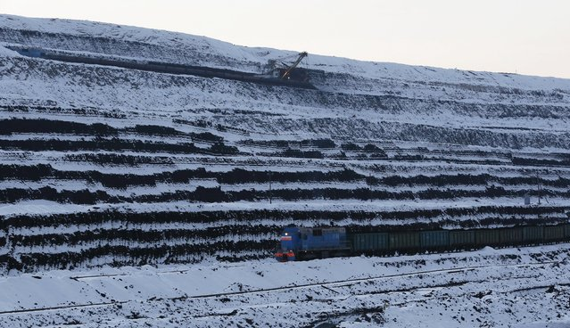 A general view shows a train along coal faces at the Borodinsky opencast colliery near the Siberian town of Borodino, east of Krasnoyarsk, October 27, 2015. (Photo by Ilya Naymushin/Reuters)