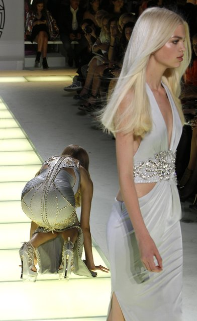 A model falls as she displays a creation as part of Versace Spring/Summer 2012 women's collection during Milan Fashion Week September 23, 2011. (Photo by Stefano Rellandini/Reuters)