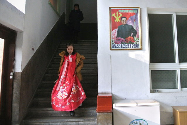 A North Korean tour guide is pictured at a history museum in the northeastern North Korean border town of Sinuiju on December 15, 2012. China is North Korea's biggest trading partner by far, and most of the business passes through Dandong in the northeast, where lorries piled high with tyres and sacks were processed at a customs post. (Photo by Wang Zhao/AFP Photo)