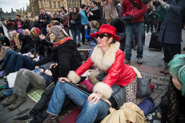 Protesters sat on each other's faces outside Parliament in direct defiance of new laws restricting the content of p*rn films made in the UK on December 12, 2014. (Photo by Vianney Le Caer/AAP Image/NewZulu)